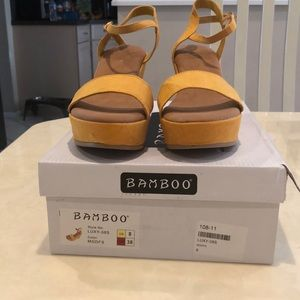 Bamboo gold suede wedges size 8.